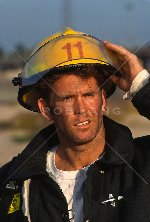 Fireman removing his helmet after work