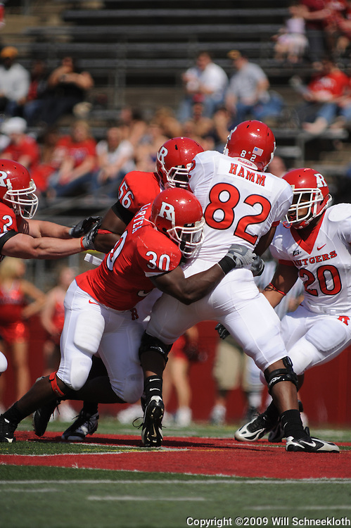 Apr 18, 2009; Piscataway, NJ, USA; Rutgers WR Marquis .Hamm (82) is tackled by LB Edmond Laryea (30) during the second half of Rutgers' Scarlet and White spring football scrimmage.