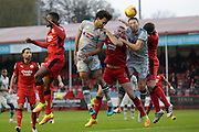 Danny Colins(22) Mark Connolly(6) and Josh Growling (6) all clash  during the EFL Sky Bet League 2 match between Crawley Town and Grimsby Town FC at the Checkatrade.com Stadium, Crawley, England on 26 November 2016. Photo by Jarrod Moore.