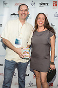 Sean Gerowin and guest on the red carpet during opening night of the 25th Anniversary New Orleans Film Festival; Opening night film is 'Black and White' directed by Mike Binder