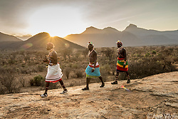 Samburu warriors walk along the ridges of the Mathews Range. This is the birthplace of humanity. The #Samburu have walked this land for time immemorial, sharing the land to the wildlife who have lived there. They have recently renewed their bonds with this wildlife and become their greatest protectors. <br /> <br /> The Samburu are the force behind northern Kenya's Reteti Elephant Sanctuary (@r.e.s.c.u.e), the first ever community-owned and run elephant sanctuary in Africa. The sanctuary provides a safe place for injured elephants to heal and later, be returned back to the wild.  You can support this incredible place and the people who protect wildlife. Buy a raffle ticket for only $10 to support Reteti.You could win a trip to Kenya, see Dave Matthews (@davematthewsband) in concert and take home Dave's handmade guitar with @prizeo (Link in profile). Not only will you be helping care for orphaned baby elephants and strengthening community ties, you'll also have a chance to win a life-changing trip to see the sanctuary in person. <br /> <br /> Reteti operates in partnership with Conservation International (@conservationorg) who provide critical operational support and work to scale the Reteti community-centered model to create even bigger, lasting impacts worldwide. The first $10,000 in funds raised will be generously matched by Elephant Gems (@elephantgems).<br /> <br /> Photo by @amivitale.