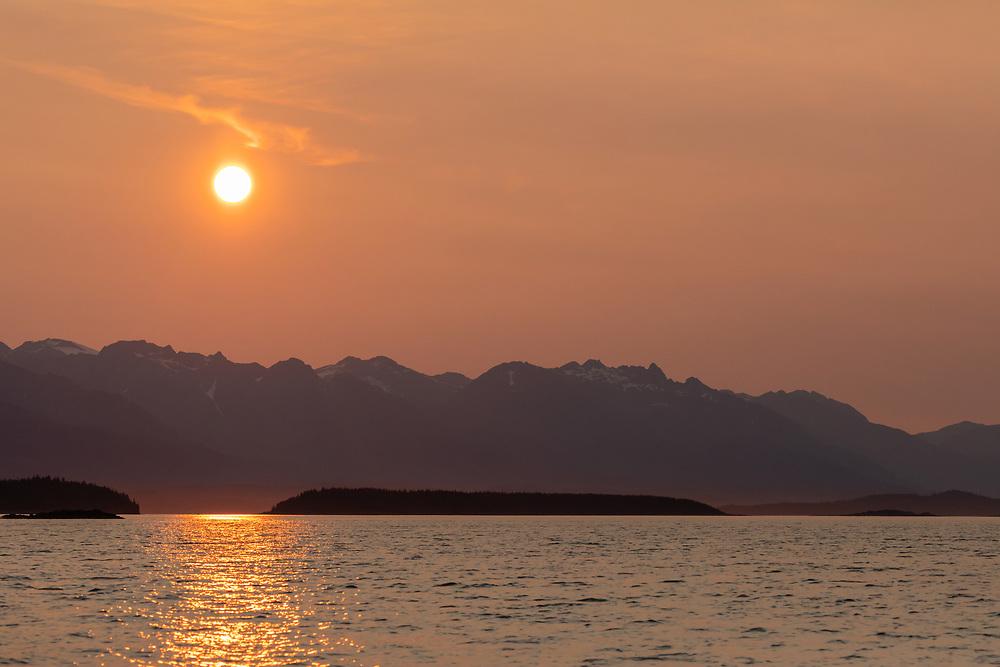 Evening sun over the Chilkat Range in Southeast Alaska. Summer.
