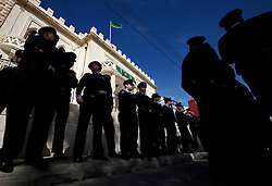 Police officers stand guard outside the Libyan Embassy during a protest in Attard, outside Valletta, February 22, 2011. The protest was organised by the Libyan community living in Malta against the Libyan government's crackdown on demonstrators in Libya..Photo by Darrin Zammit Lupi