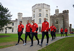 CARDIFF, WALES - Friday, October 7, 2016: Wales players stroll past Hensol Castle during a team walk at the Vale Resort ahead of the 2018 FIFA World Cup Qualifying Group D match against Georgia. Tom Bradshaw, David Edwards, Andrew Crofts, goalkeeper Adam Davies. (Pic by David Rawcliffe/Propaganda)