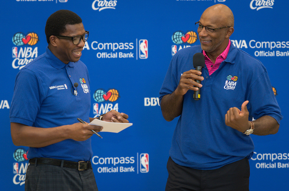 Former NBA players Felipe Lopez, left, and Clyde Drexler, right, talk with students during a financial education and success program sponsored by NBA Cares and BBVA Compass at Crespo Elementary School, February 27, 2014.