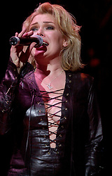 Kim Wilde steps out of the her TV Gardening clothes and Back on Stage to Tour with<br /><br />Steve Starnge (Visage)<br />Claire Grogan (Altered Images)<br />The Belle Stars<br />Dollar<br />Kim Wilde<br />The Human League<br />Play on the Here and Now  Christmas Party Tour at Sheffields Hallam FM Arena Friday 13th December 2002<br /><br />[#Beginning of Shooting Data Section]<br />Nikon D1 <br />2002/12/13 22:30:43.1<br />JPEG (8-bit) Fine<br />Image Size:  2000 x 1312<br />Color<br />Lens: 80-200mm f/2.8-2.8<br />Focal Length: 105mm<br />Exposure Mode: Manual<br />Metering Mode: Spot<br />1/200 sec - f/2.8<br />Exposure Comp.: 0 EV<br />Sensitivity: ISO 800<br />White Balance: Auto<br />AF Mode: AF-S<br />Tone Comp: Normal<br />Flash Sync Mode: Not Attached<br />Color Mode: <br />Hue Adjustment: <br />Sharpening: Normal<br />Noise Reduction: <br />Image Comment: <br />[#End of Shooting Data Section]