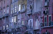 Pink tinged buildings overlooking the Port of Ischia on Ischia Island, Bay of Naples.