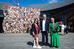 London, UK. 13 September, 2019. Ben Evans, Director of the London Design Festival, poses with guests in front of Martino Gamper's Disco Carbonara installation in Coal Drops Yard as a Festival Commission for the London Design Festival. A 'false facade of a disco with a fresh take on traditional cladding from the Italian Alps', it is designed as a gateway and inspired by the concept of a Potemkin village as built to impress Empress Catherine II by her lover Grigory Potemkin during her journey to Crimea in 1787.