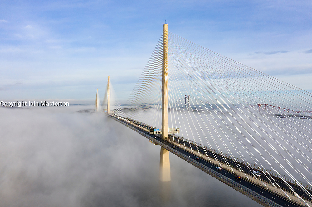 South Queensferry, Scotland, UK. 10th Jan 2020. Drone image of a spectacular cloud inversion at Queensferry Crossing Bridge with the lower half of the bridge shrouded in fog but the upper half in beautiful sunny weather. In background the Forth Bridge and Forth Road Bridge. Iain Masterton/Alamy Live News