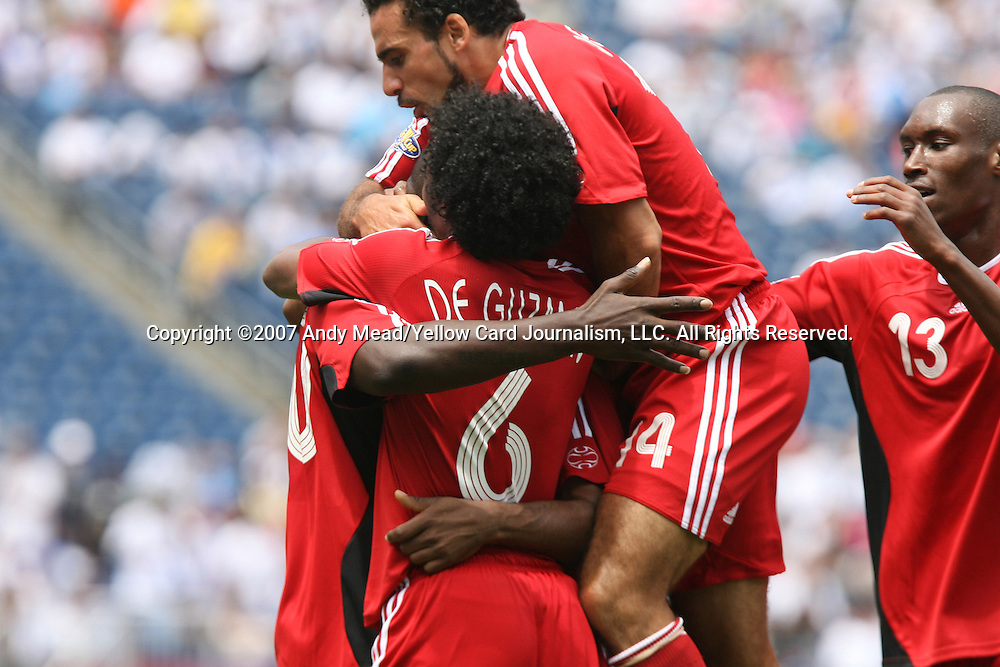 16 June 2007: Canada's Dwayne DeRosario (14) celebrates scoring a goal in the 17th minute with Ali Gerba (l), Julian DeGuzman (6) and Atiba Hutchinson (13). The Canada Men's National team defeated the Guatemala Men's National Team 3-0 at Gillette Stadium in Foxboro, Massachusetts in a 2007 CONCACAF Gold Cup quarterfinal.