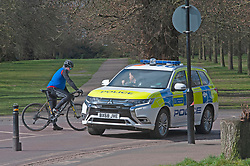 ©Licensed to London News Pictures 31/03/2020  <br /> Greenwich, UK. Police talking to a cyclists while on covid19 patrol in the park. People get out of the house from Coronavirus lockdown to exercise in Greenwich Park, London. The Prime Minister Boris Johnson has asked people to stay at home to help in the fight against Covid-19 and to only go out for essential reasons. credit:Grant Falvey/LNP