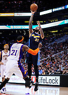 Mar. 10, 2011; Phoenix, AZ, USA; Denver Nuggets forward Chandler Wilson (21) puts up a basket against the Phoenix Suns forward Hakim Warrick (21) at the US Airways Center. Mandatory Credit: Jennifer Stewart-US PRESSWIRE