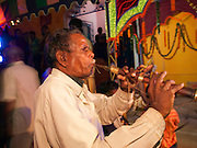 This man has been playing the musical instrument at special occassions in this village for over 40 years.