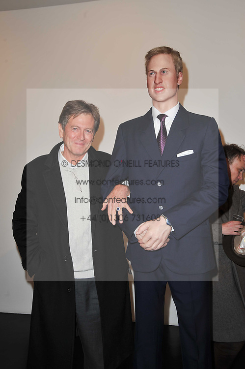 JOHN PAWSON with a statue of Prince William at a private view of 'Engagement' an exhibition of new works by Jennifer Rubell held at the Stephen Friedman Gallery, 25-28 Old Burlington Street, London on 7th February 2011.