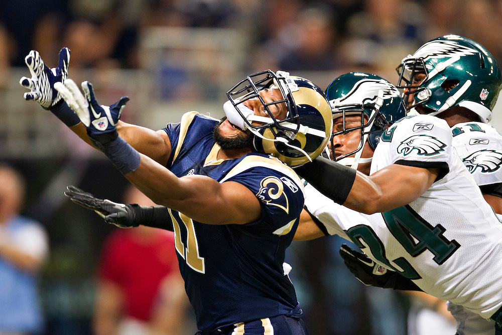 ST. LOUIS, MO - SEPTEMBER 11:   Brandon Gibson #11 of the St. Louis Rams is interfered with while trying to make a catch by Nnamdi Asomugha #24 of the Philadelphia Eagles at the Edward Jones Dome on September 11, 2011 in St. Louis, Missouri.  The Eagles defeated the Rams 31 to 13.  (Photo by Wesley Hitt/Getty Images) *** Local Caption *** Brandon Gibson; Nnamdi Asomugha