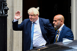 © Licensed to London News Pictures. 26/09/2019. LONDON, UK.  London, UK.  26 September 2019.  Boris Johnson (L), Prime Minister, departs from Number 10 Downing Street to head to Parliament.  Photo credit: Stephen Chung/LNP