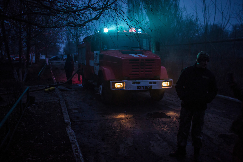 ARTEMIVSK, UKRAINE - FEBRUARY 14: A fire truck on the scene of an artillery strike that hit a dormitory on February 14, 2015 in Artemivsk, Ukraine. A ceasefire between Ukrainian forces and pro-Russian rebels is scheduled to go into effect at midnight. (Photo by Brendan Hoffman/Getty Images) *** Local Caption ***