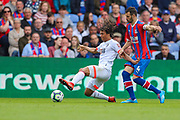 Bournemouth defender Nathan Ake (5) performs a sliding tackle on Crystal Palace midfielder Luka Milivojevic (4) during the Premier League match between Crystal Palace and Bournemouth at Selhurst Park, London, England on 12 May 2019.