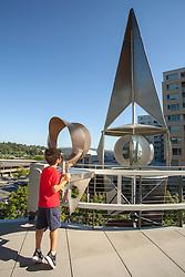United States, Washington, Bellevue, boy at outdoor metal sculpture on terrace of Bellevue City Hall  MR