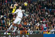 Raúl Albiol fights for Aerial ball