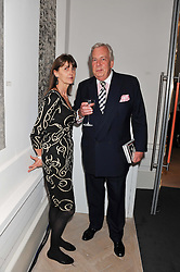 DAVID McDONOUGH and CAROLYN HADDEN-PATON at a party to celebrate the publication of Mum's The Word by Eve Branson held at Grace, West Halkin Street, London on 11th March 2013.