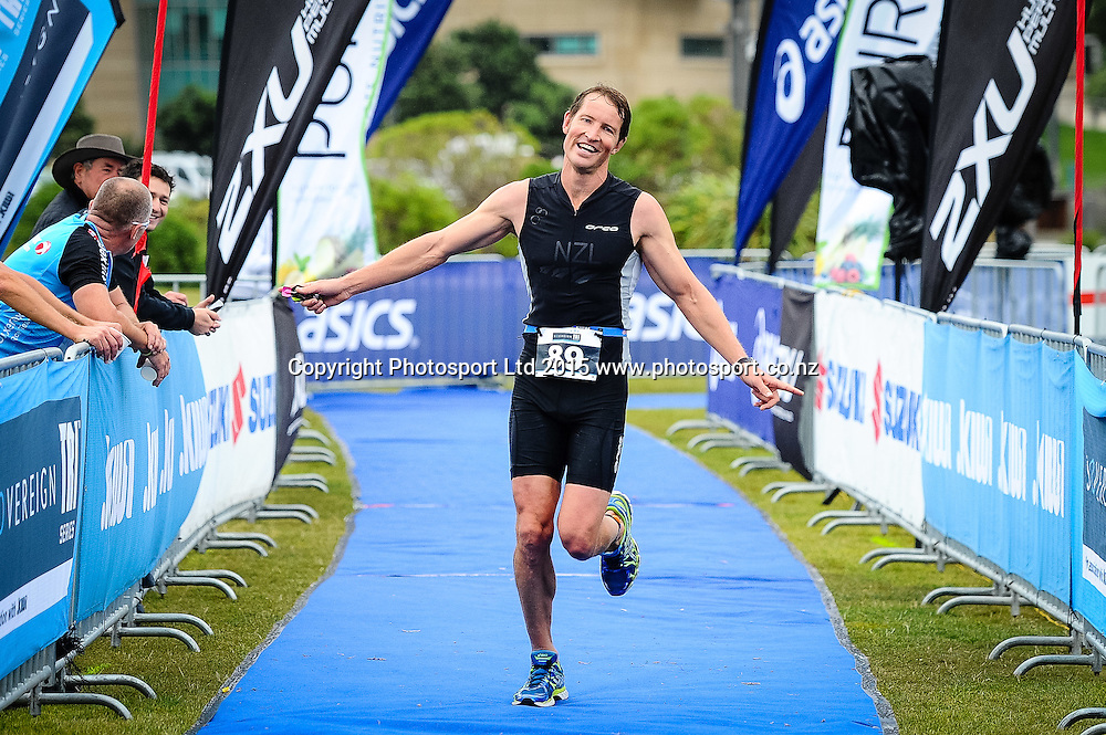 A competitor runs down the chute at the finish line of the Sovereign Tri Series, Waterfront, Wellington, New Zealand. Saturday 14 March 2015. Copyright Photo: Mark Tantrum/www.Photosport.co.nz