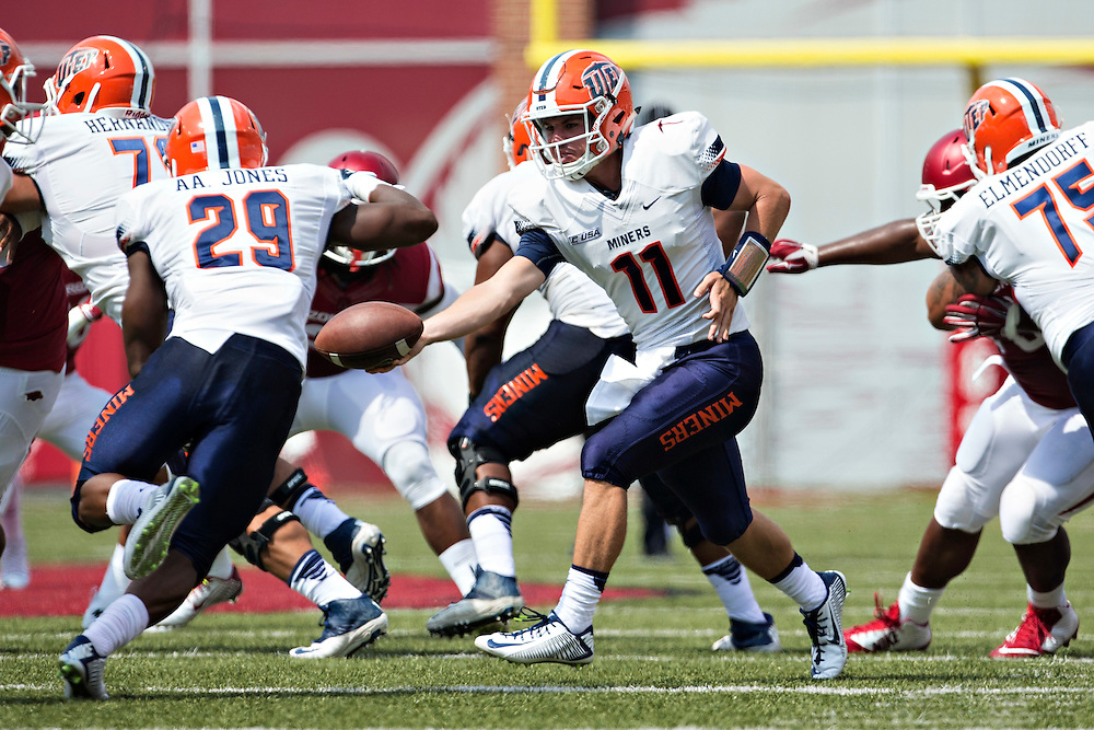 FAYETTEVILLE, AR - SEPTEMBER 5:  Mack Leftwich #11 hands off the ball to Aaron Jones #29 of the UTEP Miners during a game against the Arkansas Razorbacks at Razorback Stadium on September 5, 2015 in Fayetteville, Arkansas.  The Razorbacks defeated the Miners 48-13.  (Photo by Wesley Hitt/Getty Images) *** Local Caption *** Mack Leftwich; Aaron Jones