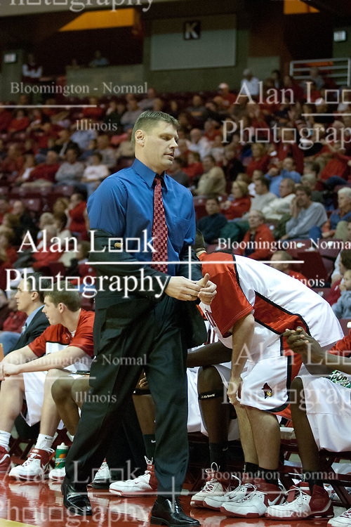 02 December 2006: Coach Porter Moser disgustedly takes off his jacket. In a non-conference game, the Mavericks of University of Texas at Arlington lost to the Redbirds home 86-61. The win was the 5th in a row for the Redbirds, the longest winning streak in 6 years. the game was played at Redbird Arena in Normal Illinois on the campus of Illinois State University.<br />