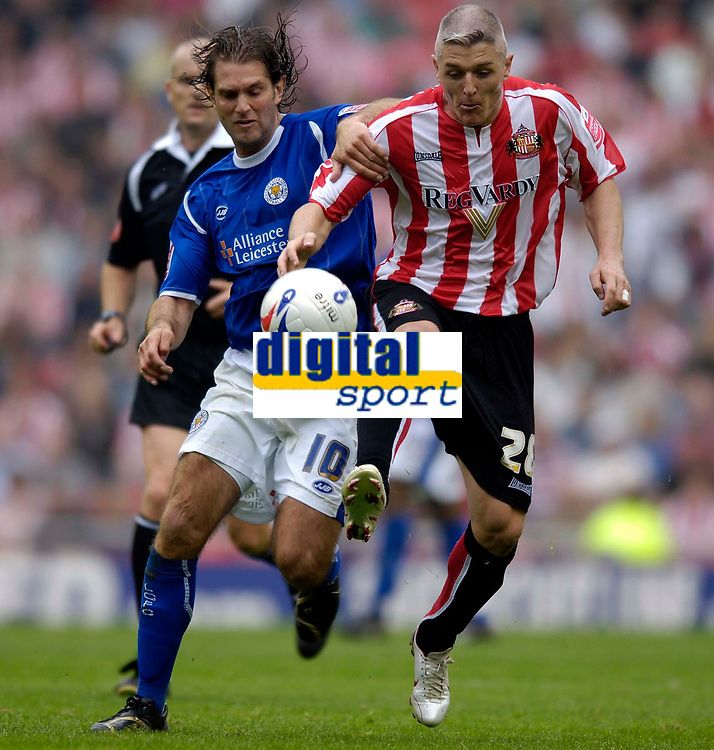 Photo: Jed Wee.<br />Sunderland v Leicester City. Coca Cola Championship. 16/09/2006.<br /><br />Sunderland's Graham Kavanagh (R) tussles with Leicester's Andy Johnson.
