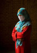 Young Uyghur woman, Keriya, Xinjiang Uyghur Autonomous Region, China.