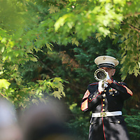 """Ret. Marine Corps Master Gunnery Sgt. Bob Verell plays """"taps"""" to end this year's Memorial Day service at Veterans Park in Tupelo Monday."""
