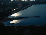 Nederland, Noord-Holland, Naardermeer, 17-10-2005; oudste natuurreservaat van Nederland in bezit van Vereniging voor Natuurmonumenten (grondlegger Jac. P. Thijsse), tegenlichtopname met glimmende treinrails; momenteel wordt het gebied uitsluitend doorsneden door de spoorlijn, er zijn echter plannen om dwars door het gebied de A6 - A9 aan te leggen (tussen Almere en Schiphol); milieu, geluidsoverlast,  automobiliteit, tolweg, verkeer. protest; zie ook andere (lucht)foto's van deze lokatie..Nature reserve Naardermeer (Naarder lake) ,  the areaa is a bird sanctuary and the oldest Dutch nature preserve; wetland, wetlands, marshland, marshlands..Swart Collection, aerial view / aerial photo (additional fee required)<br /> Foto Siebe Swart