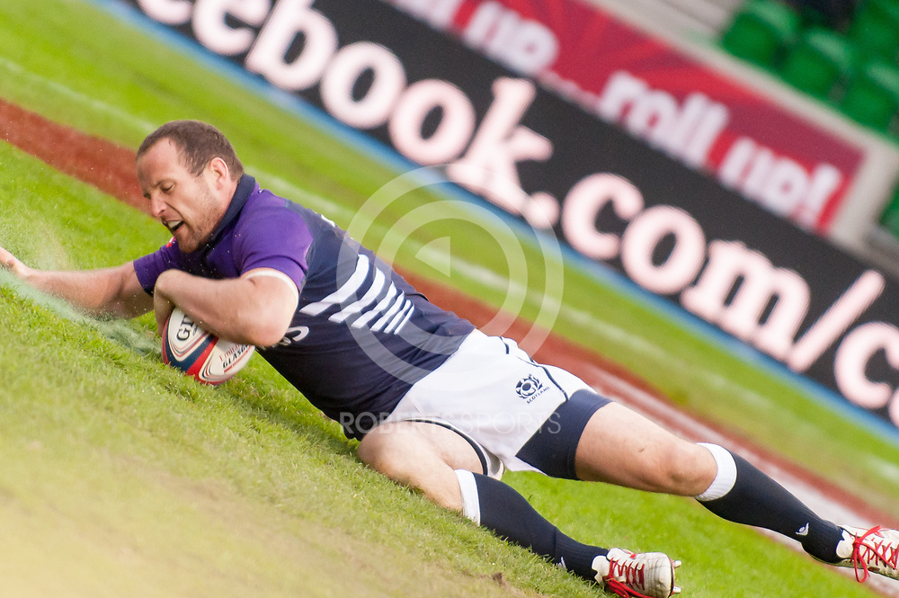 Scotland's James Eddie touches down for a try against Spain. Action from the IRB Emirates Airline Glasgow 7s at Scotstoun in Glasgow. 3 May 2014. (c) Paul J Roberts / Sportpix.org.uk