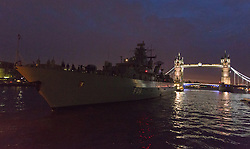 © Licensed to London News Pictures. 24/01/2014. London, UK. German frigate FGS Schleswig-Holstein F216 arrives in London under Tower Bridge at 6:50am on Friday 24 January 2014 and takes a temporary berth next to HMS Belfast. FGS Schleswig-Holstein is a Type 123, Brandenburg-class frigate belonging to the German Navy and measures 139 meters in length. Photo credit : Vickie Flores/LNP