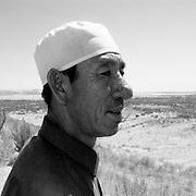 Man at desert reclaimation project, Ningxia, China