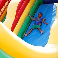 "Thomas Wells | Buy at PHOTOS.DJOURNAL.COM<br /> Charles ""Cam"" McFadden, 9, enjoys a childrens slide at Saturday's Community Foward festival held at Gumtree Park in Tupelo."