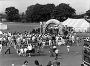 "Guinness Family Day At The Iveagh Gardens. (R83)..1988..02.07.1988..07.02.1988..2nd  July 1988..The family fun day for Guinness employees and their families took place at the Iveagh Gardens today. Top at the bill at the event were ""The Dubliners"" who treated the crowd to a performance of all their hits. Ireland's penalty hero from Euro 88, Packie Bonner, was on hand to sign autographs for the fans...Image shows the Dubliners on stage entertaining all the families who turned out for the Guinness Family Fun Day at Iveagh Gardens."
