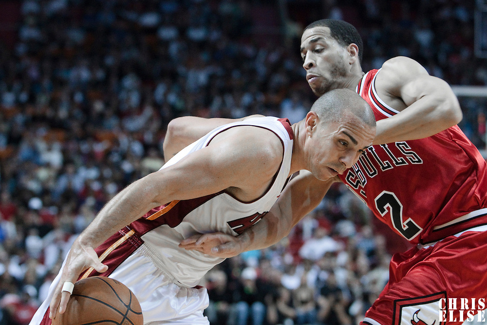 12 March 2010:  Miami Heat guard Carlos Arroyo dribbles against Chicago Bulls guard Jannero Pargo during the Miami Heat 108-95 victory over the Chicago Bulls at the AmericanAirlines  Arena, in Miami, Florida, USA.
