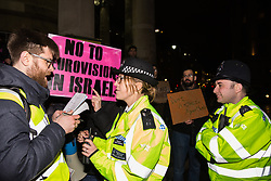 London, UK. 8th February, 2019. Police officers place restrictions on pro-Palestinian activists attending a 'Love Eurovision, Hate Apartheid!' protest outside BBC Broadcasting House organised by London Palestine Action to call on the BBC to withdraw from the 2019 Eurovision Song Contest hosted by Israel so as to avoid complicity in 'artwashing' Israel's violations of Palestinian human rights. The protest formed part of a global campaign to Boycott Eurovision in Israel.