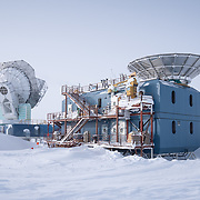 The Dark Sector Lab with the South Pole Telescope on left and BICEP3 on the right. Both telescopes are studying the CMB (cosmic microwave background).