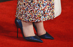 In the frame - Jennifer Lawrence shoes.<br /> Jennifer Lawrence arrives for The Hunger Games: Catching Fire premiere, Leicester Square, London, United Kingdom. Monday, 11th November 2013. Picture by Andrew Parsons / i-Images