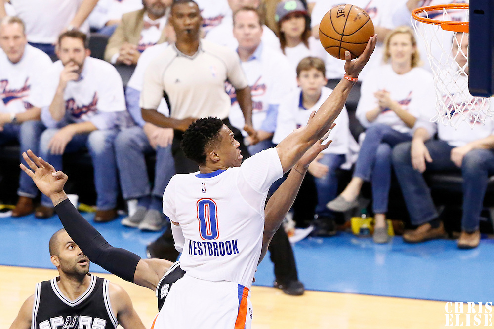 06 May 2016: Oklahoma City Thunder guard Russell Westbrook (0) goes for the layup during the San Antonio Spurs 100-96 victory over the Oklahoma City Thunder, during Game Three of the Western Conference Semifinals of the NBA Playoffs at the Chesapeake Energy Arena, Oklahoma City, Oklahoma, USA.