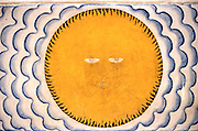 Painted Sun on a temple wall at Aluthgama.