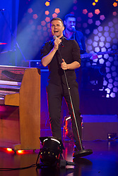 Repro Free: 06/12/2013 Gary Barlow is pictured performing live on the RTE Late Late Show. Picture Andres Poveda