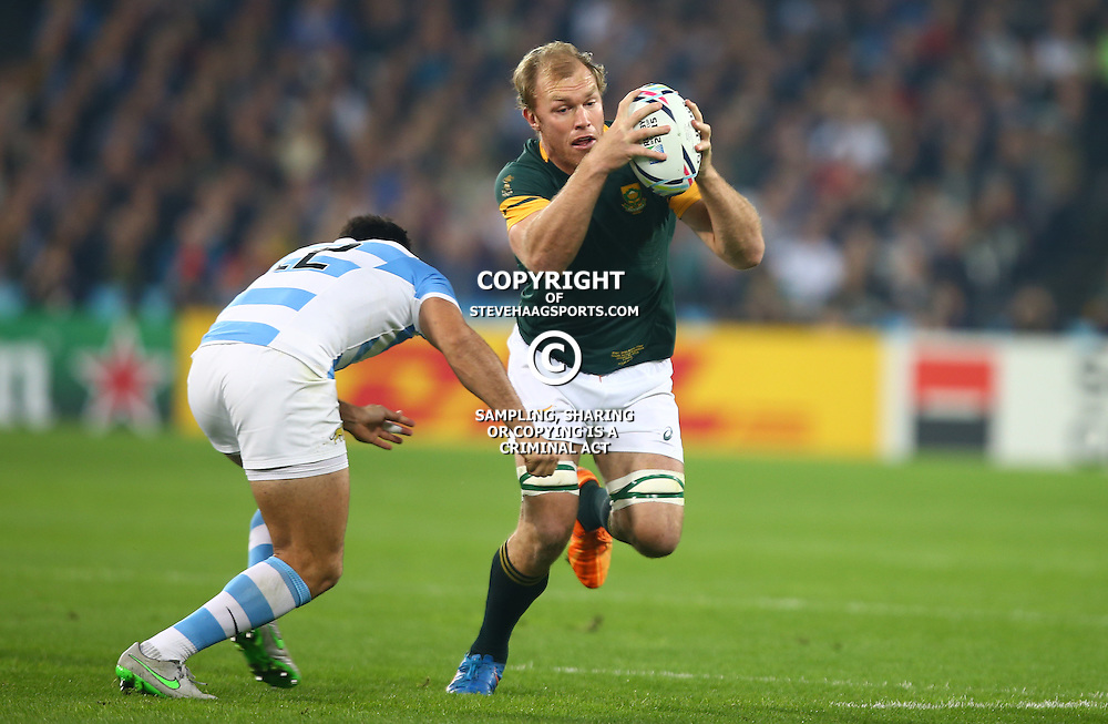 LONDON, ENGLAND - OCTOBER 30:Jeronimo De La Fuente of Argentina looks to tackle Schalk Burger of South Africa  during the Rugby World Cup 3rd Place Playoff match between South Africa and Argentina at Olympic Stadium on October 30, 2015 in London, England. (Photo by Steve Haag/Gallo Images)