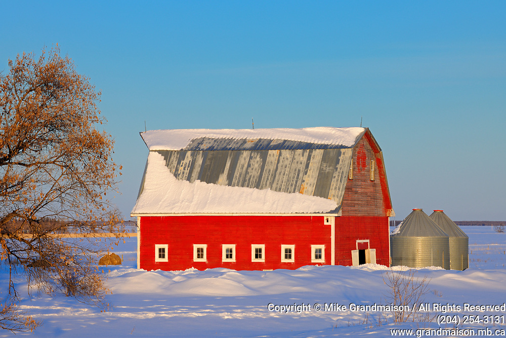 Red barn at sunset<br />