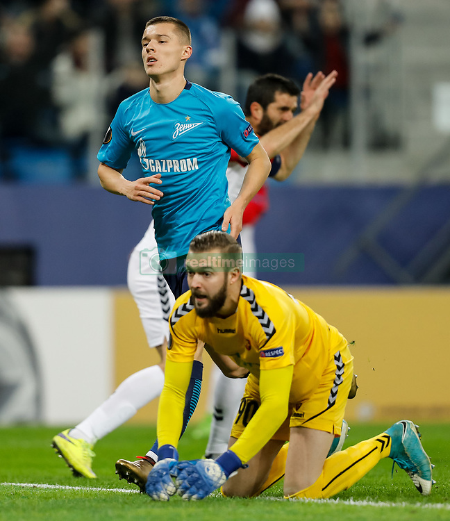 November 23, 2017 - Saint Petersburg, Russia - Filip Gachevski (in front) and Boban Grncharov (on the background) of FK Vardar react after Dmitri Poloz (C) of FC Zenit Saint Petersburg scored a goal during the UEFA Europa League Group L match between FC Zenit St. Petersburg and FK Vardar at Saint Petersburg Stadium on November 23, 2017 in Saint Petersburg, Russia. (Credit Image: © Mike Kireev/NurPhoto via ZUMA Press)