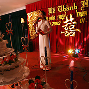 An MC introduces the bride and groom at a wedding reception in Phan Thiet, Vietnam. Weddings in the Communist nation have become increasingly lavish and ostentatious in recent years, often bankrupting families as they try and show off new wealth. The government has repeatedly asked publics servants to lead by example with  more modest nuptials.