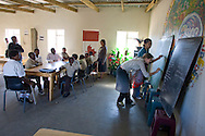 Students from Waterford Kamhlaba college teaching English to orphaned children at a school at Mpolongeni, Swaziland. The Kingdom of Swaziland (population 1.1m), a small, landlocked country in southern Africa was bordered by South Africa on three sides and Mozambique to the east, with Mbabane as its administrative capital. At the start of the 21st century, the country had the highest incidence per head of population of HIV/Aids in the world and and high levels of poverty mainly in rural areas where 75 per cent of the population lived.