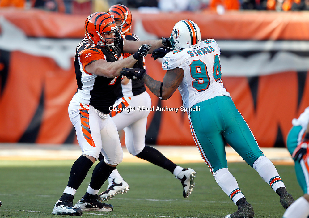 Cincinnati Bengals offensive tackle Andrew Whitworth (77) pass blocks Miami Dolphins defensive end Randy Starks (94) during the NFL week 8 football game on Sunday, October 31, 2010 in Cincinnati, Ohio. The Dolphins won the game 22-14. (©Paul Anthony Spinelli)